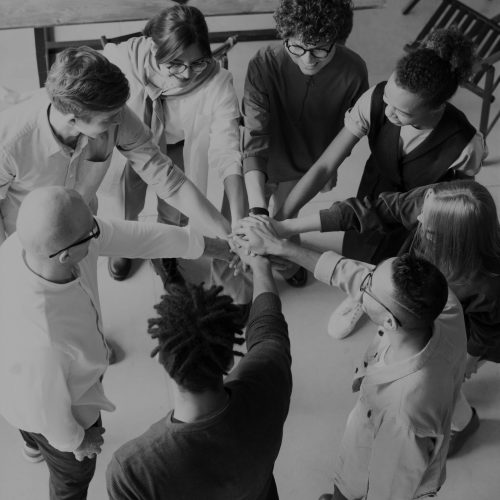 photo-of-people-holding-each-other-s-hands-3184423